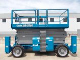 Side View of Used 2006 Genie GS-5390 Blue Scissor Lift